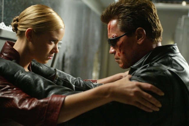 Oct 16, 2002; Hollywood, USA; Actors KRISTANNA LOKEN as T-X and ARNOLD SCHWARZENEGGER as The Terminator star in the futuristic action thriller movie 'Terminator 3: Rise of the Machines.'  Mandatory Credit: Photo by Warner Bros./ZUMA Press.  (©) Copyright 2002 by Warner Bros.